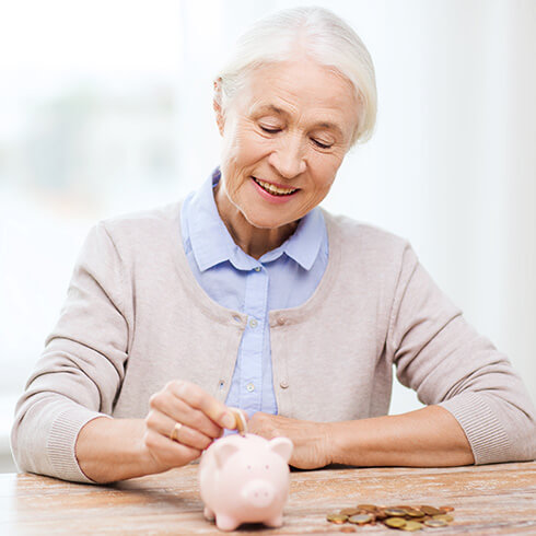 older woman with piggy bank
