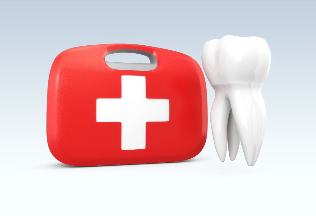 A red first aid kit next to a tooth indicating a dental emergency